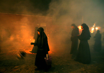 Catholics take part in an evening procession in Antigua, Guatemala