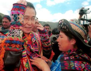 PERUVIAN PRESIDENT FUJIMORI TALKS WITH ANDEAN WOMAN IN HUANCAVELICA.
