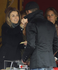 Spain's Princess Letizia places a sticker on a donor's coat in Madrid