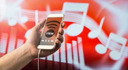 In de dag Muziekwinkel Close up of a man holding smartphone in hand and listening to music with mobile app. Red blurred note background. Modern online music streaming concept with free copy space for text.