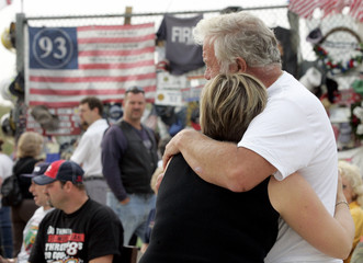 Woman hugs her father at the Flight 93 Temporary Memorial just outside Shanksville