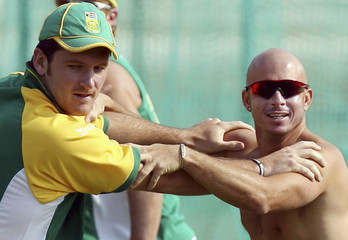 South Africa's Smith and Gibbs warm up at the practice session in Jaipur