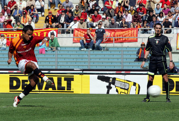 AS Roma's Mancini scores a penalty against Lecce during their Serie A soccer match in Rome