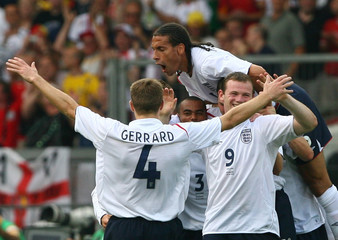 England players celebrate after David Beckham scored his team's first goal during their second round World Cup 2006 soccer match against Ecuador in Stuttgart