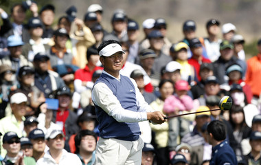 Choi of South Korea watches his tee shot on the 10th hole in Seogwipo