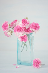 Close-up floral composition with a pink roses. Beautiful fresh pink roses on a table.