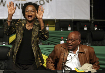 Secretary-General of the ANC Mbethe waves to supporters as newly elected ANC president Zuma looks on during the third day of a leadership conference in Polokwane