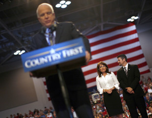 Republican vice presidential nominee Alaska Governor Palin and her husband Todd listen as Republican presidential nominee Senator McCain speaks during rally in Virginia Beach