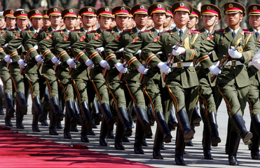 Chinese soldiers march during a parade at a welcome ceremony for French Prime Minister Jean-Pierre ...