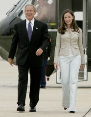 U.S. President George W. Bush and daughter, Barbara, walk from Marine One towards Air Force One at A..