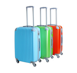 Three suitcases isolated on white background. Polycarbonate suitcases isolated on white. Blue, green and red suitcases.