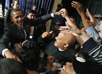 US Democratic presidential nominee Senator Barack Obama (D-IL) greets supporters as he leaves a campaign event in Toledo
