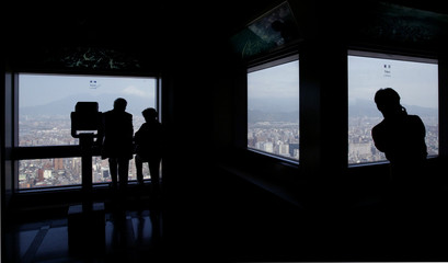 VISITORS ADMIRE A GENERAL VIEW OF TAIPEI CITY.