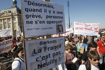 Public and private sector workers attend a protest march in Bordeaux