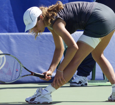 SWISS PLAYER GAGLIARDI STRETCHES LEG MUSCLE DURING SECOND ROUND WIN OVER MARTINEZ AT THE ...