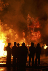 Onlookers stand as fire engulfs a chemical factory at Panchkula in Haryana