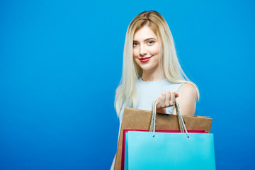9763477240c7 Portrait of Happy Blonde with Long Hair and Dress on Blue Background.  Smiling Sensual Woman