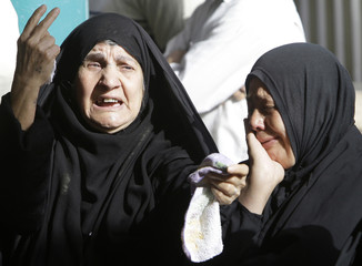 Women grieve during funeral of Al-Baghdadiya television station correspondent Adnan who was killed in a bomb attack in Baghdad