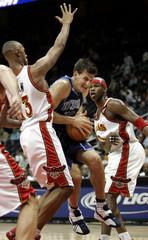 Atlanta Hawks Diaw and Harrington defend against Jazz Giricek during NBA action in Atlanta.