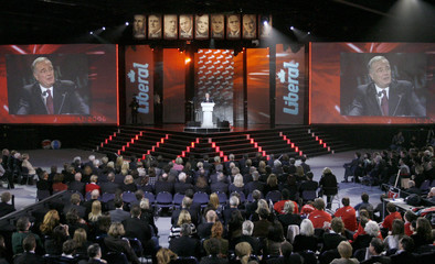 Paul Martin takes the stage during a tribute in his honour at the Liberal convention in Montreal