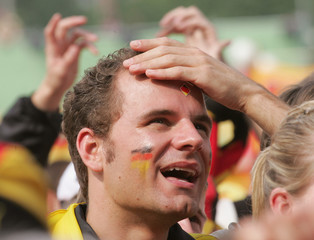 German fan reacts during the World Cup soccer match between Ecuador and Germany in Hanover