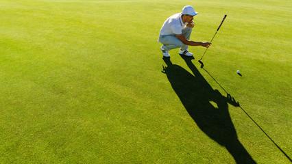 Foto op Aluminium Golf Golfer checking line for putting golf ball