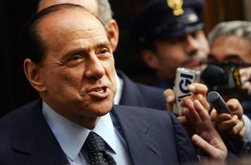 Italian Prime Minister Silvio Berlusconi leaves Palazzo Chigi in Rome