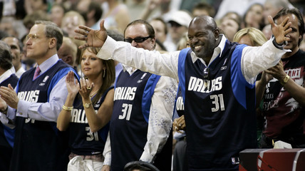 Former Dallas Cowboys running back Smith and fans wear Mavericks guard Terry jerseys in support of Terry during 2006 NBA playoffs in Dallas