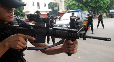 A group of Indonesian anti-terror police officers perform during an exercise in Jakarta