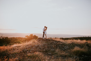 couple kissing on field