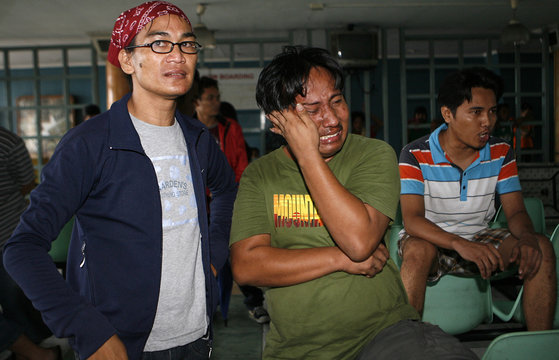 Anxious relatives of passengers feared trapped inside Princess of the Stars wait for the latest news on their love ones inside the Sulpicio Lines terminal in the port area of Manila