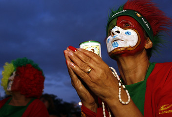 Portugal soccer fan prays during the World Cup 2006 soccer match between Portugal and France in Lisbon