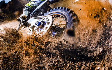 Close-up of motocross wheel.