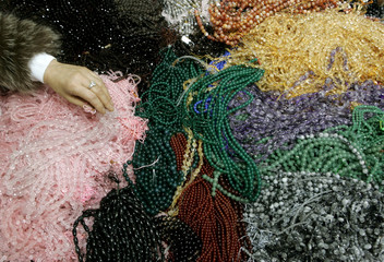 A buyer chooses precious stones at the 19th International Jewellery Tokyo 2008 fair in Tokyo