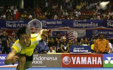 China's Chen Jin play a shot against Malaysia's Muhammad Hafiz Hashim during the semifinal of the Thomas Cup badminton championships in Jakarta