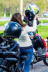 Girl biker in a leather jacket