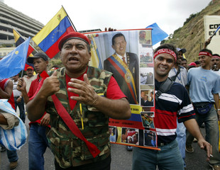 SUPPORTERS OF PRESIDENT CHAVEZ MARCH IN CARACAS.