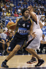 Argentina's Scola drives the ball against Canada's Kendall during their Marchand Continental Championship Cup basketball game in San Juan