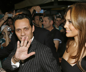 Marc Anthony and Jennifer Lopez arrive at Land Shark Stadium for the NFL football game between the Miami Dolphins and the Indianapolis Colts in Miami