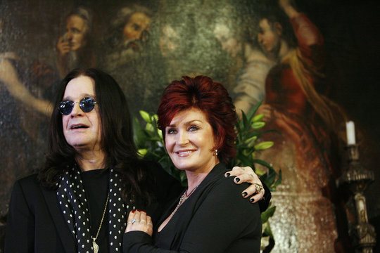Ozzy and Sharon Osbourne pose in front of their belongings in Beverly Hills