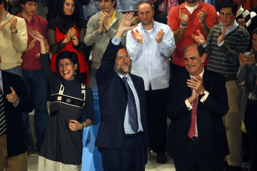 Spanish opposition leader  Rajoy waves next Partido Popular leaders Gil and Astarloa during an electoral meeting in Bilbao.