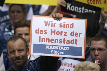 Demonstrator protests against Arcandor's policy on department store chain Karstadt in Berlin