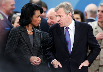US Secretary of State Rice talks with NATO Secretary-General de Hoop Scheffer at NATO headquarters in Brussels