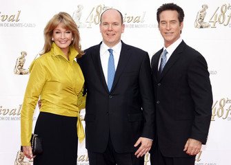 Prince Albert of Monaco poses with Actress Deidre Hall actor Drake Hogestyn during the opening night of the 48th Monte Carlo television Festival in Monaco