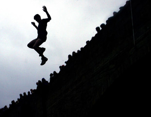 A MAN LEAPS FROM A BRIDGE INTO RIVER DOVE DURING A TRADITIONAL NEW YEARS DAY ANNUAL CHARITY EVENT IN ...
