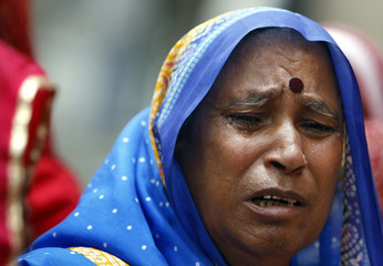 Relative cries during funeral of bomb blast victim in the western Indian city of Jaipur