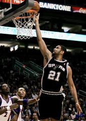 San Antonio Spurs Tim Duncan scores against Phoenix Suns.
