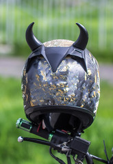 Old scratched motorcycle helmet