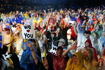 Country music fans cheer in the rain in Nashville, Tennessee.