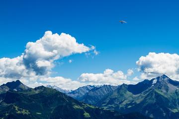 High mountains landscape with hang glider in soaring flight. Austria, Tirol, Zillertal